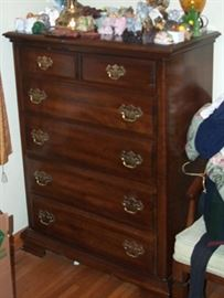 High boy dresser (46 in. H x 36 in. W) and sample of elephants