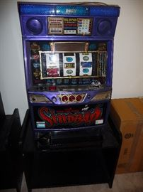 SLOT MACHINE-TAKES TOKENS BUT CAN BE CONVERTED TO COIN