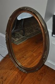 One of two oval mirrors