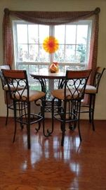 Bistro table with four swivel seat stools; wrought iron and oak