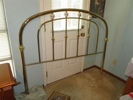 Queen Brass bed with mattresses. We have it set up.