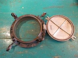 Large ship porthole with storm cover