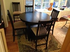 Black Round Under Storage Pub Table w/ Two Leaves and Five Black Upholstered Seat Pub Chairs