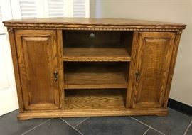 Solid oak corner entertainment. Perfect for space savings.