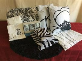 Lot # 5 - Charcoal Gray Black / White Bed and Bath Ensemble.  Bed skirt, Comforter, 2 Pillow Cases, 2 Small Pillows, Small Round Area Rug, 3 Piece Bathroom Set, Large Towel, Hand Towel and Washcloth - Queen $ 60.00