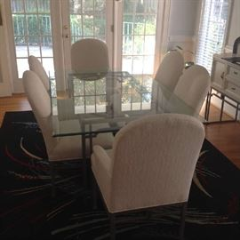 """Beveled Glass top dining table with ornate metal base and 6 chairs (2 captains).  Table - 44"""" wide x 72"""" long x 29"""" tall.  Chairs 40"""" to top of back and 20"""" to seat bottoms.  Very minor wear / small stains on 2 of the chairs.  $ 400.00"""