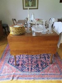 oriental rugs, cherry expandable table, china crystal
