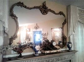 Beautiful gold frame mirror with lots of intricate carvings.