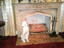 Ceramic guard dog sitting near original stone fireplace