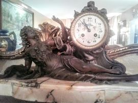 What a magnificent bronze mantle clock of woman housed on a solid marble base. Clock has Key!