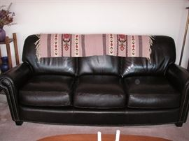 Dark brown leather sofa w/Norwegian embroidery on the back