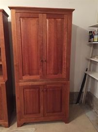 Light cherry finish wall unit with doors (there are 2 wall units - one with door the other without)