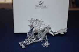 Many Swarovski Crystals in the Butler Estate. Some are pictured here but there are many more! I hope to add those pics before the sale. All have their original boxes. Pictured here is a Swarovski Crystal Year of the Dragon.
