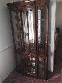 Lighted, mirrored curio cabinet