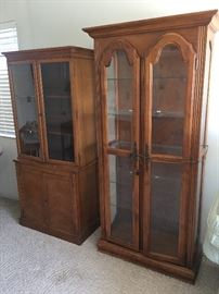 Two of three glass fronted bookcases/display cases. With adjustable shelving, storage.  Wood.