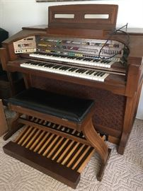 Lowrey organ with seat.  Music books.  Working condition.  Has been covered for 20 years!  Excellent condition.
