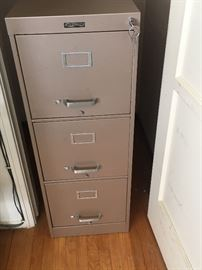One of many steel case heavy duty filing cabinets with locks.
