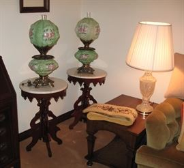 The Gone With the Wind Lamps shown here with the Victorian round marble top tables.