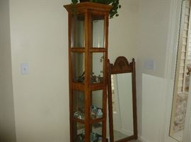 Curio cabinet and wood frame mirror.