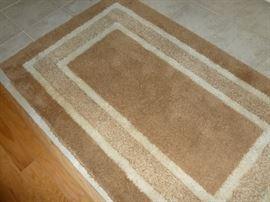 Lots of nice area rugs.