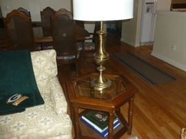 Nice table with glass top and rattan lower shelf.