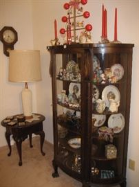 Antique curved glass-front display cabinet, Queen Anne end table, retro table lamp