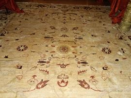 A ROOM SIZE OUSHAK STYLE CARPET