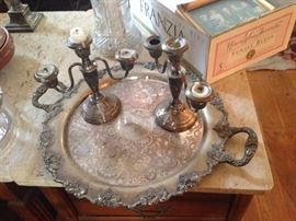 Weighted candle holders on silver tray