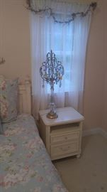 bedroom side table with ornate lamp