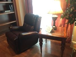 Comfortable leather recliner, table lamp and end table (matches coffee table in living room which is pictured later)