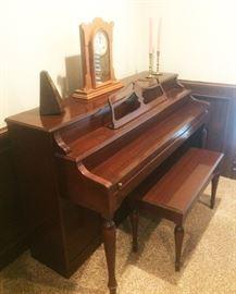 piano, metronome, candlesticks