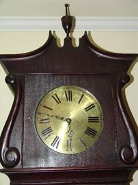 Brass face of tall case clock