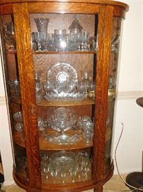 china cabinet filled with glass and crystal