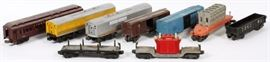 Lot#3088, LIONEL, POST-WAR, O27 GAUGE, FREIGHT CARS, C1946-60, 9 PCS.Includes: one #2461 Transformer car; #6519 'Allis-Chalmers' flatcar; #6464-475, Boston & Maine, boxcar; #2452 Pennsylvania gondola; #X2758 Pennsylvania 'Automobile Merchandise', boxcar; #3461 Lionel Lines, Operating Log Car; #2625 'Irvington' Pullman car and one #2343 Santa Fe 'B' unit'. 9 pcs. total.