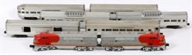 Lot#3060, LIONEL, SANTA FE, O GA, PASSENGER TRAIN, POST WAR, 8 PCS.Includes a Santa Fe #2333 F3 Diesel and 'AA' unit; a 2530 'REA' baggage car; #2531 'Silver Dawn' observation car; two #2532 'Silver Range' vista dome cars; #2533 'Silver Cloud' Pullman; #2534 'Silver Bluff' Pullman.