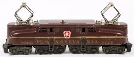 Lot#3063, LIONEL  O GA PENNSYLVANIA GGI ELECTRIC LOCOMOTIVE, TUSCAN COLOR, POST WAR C1960. Lionel o gauge Pennsylvania GG1 'Electric', Tuscan color with gold stripe decal letters, circa 1960.