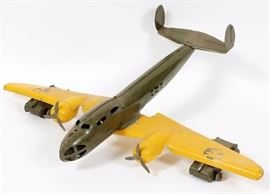 "Lot#3122, BUDDY-L, PRESSED STEEL, BOMBER PLANE WITH TANKS, C1950, H 6"" W 24"", L 20""Buddy-L pressed steel bomber plane army tanks under each wing. Olive green body with yellow wings."