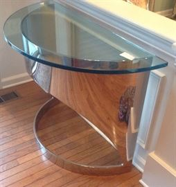 Greenbaum's modern chrome base glass top console