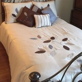 Bedspread, shams, and pillows are for sale, not the bed.