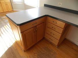 corian counter tops oak kitchen cabinets stainless steel sink