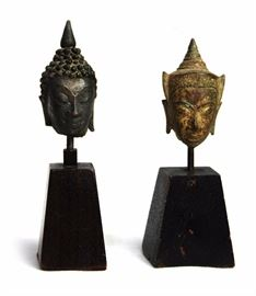 2. PAIR BUDDHA HEADS佛頭像一組                             A pair of small mounted Buddha heads on wooden bases. H:5 1/2in - 5 1/4in