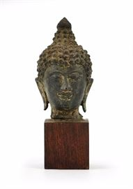 1. BUDDHA HEAD ON STAND佛頭像                             A figure of Buddhas head with his eyes closed – made of metal.H: 6 in   W: 2 in