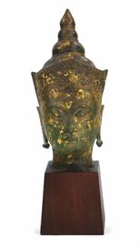 4. GILDED MOUNTED BUDDHA HEAD銅鎏金佛頭像A gilded figure of Buddha's head. 32cm H  11cm W