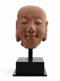 10. TANG DYNASTY (618-907) BUDDHA HEAD (CERT.AUTH)唐 石佛像 附證書TANG DYNASTRY (618-907) A light terra-cotta colored stone buddha head carving on a customized stand and with certification. H:12 1/2in  W:5 1/2in