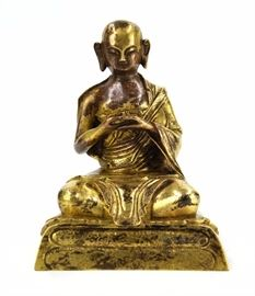 8. SEATED LAMA FIGURINE铜鎏金西藏佛造像A bronze lama seated on a lotus pad with his hands together. H:5 3/4 in  W: 4 3/8 in