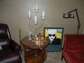 Mid-century cherry glass-top table. Print by Patrick Nagel. Modern candelabra lamp. Vintage floor lamp.