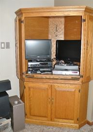 Massive oak entertainment armoire from Whitacre's. TVs, Tivo system, VHS players