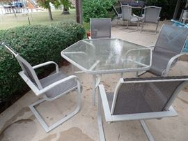 Outside Patio Set with Table and four(4) chairs. Table has opening for umbrella.