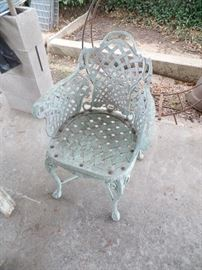 One (1) Heavy cast iron Patio Chair.