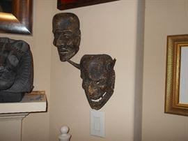 the spirit masks are light, the stone carving seems like basalt